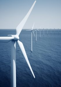 3d rendering of windturbines on the ocean